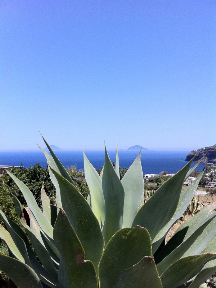 In the distance, the spitting, rumbling, smoke spewing active volcano of Stromboli.